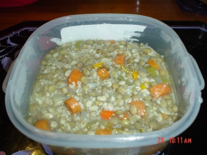 A serving of lentil soup with barley and quinoa.
