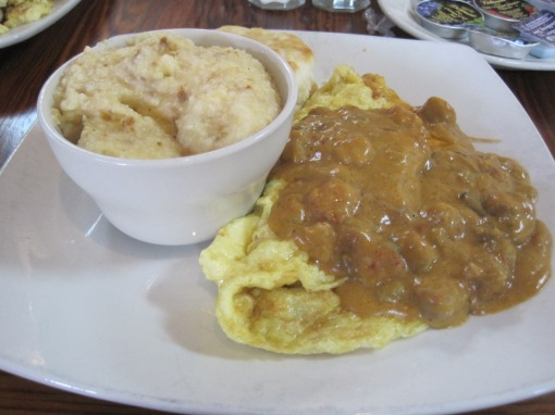 Big hat (omelette and etouffee) with some andouille grits.