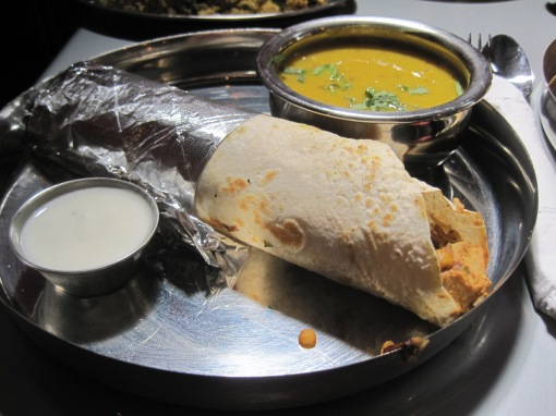 Kathi kabab roll, and bowl of daal., The daal runs a little thin.