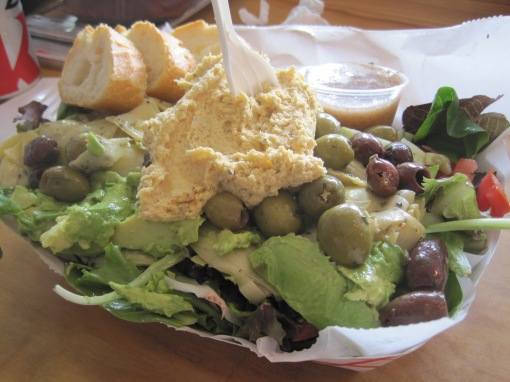 Mediterranean salad. The veggie sandwich and the mediterranean share many of the same ingredients.