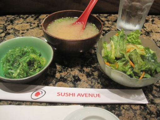 miso soup and some seaweed salad.