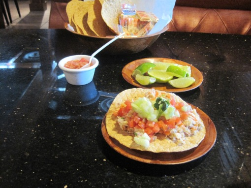 Tortillas are large, crisp, corn based and a little granular on the tongue. The tostada appetizer is better than anything I ever had at Lobster House.