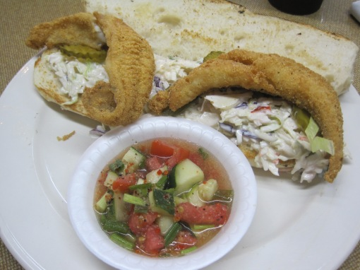 Romie's catfish po-boy, marinated cukes and tomatoes.