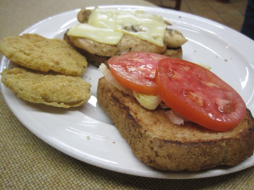 Grilled chicken on wheatberry bread with fried green tomatoes.